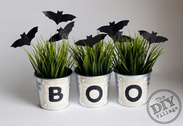 Spooky bats atop of ornamental grass in aluminum planters.