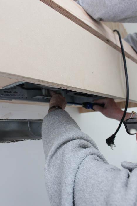 Putting in the fan housing.