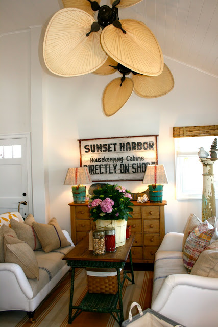 Polished pebble beachy decor with a fan light fixture.