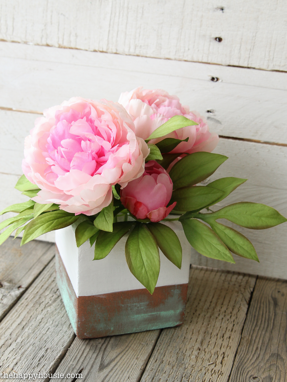 Three peonies arranged in the vase.