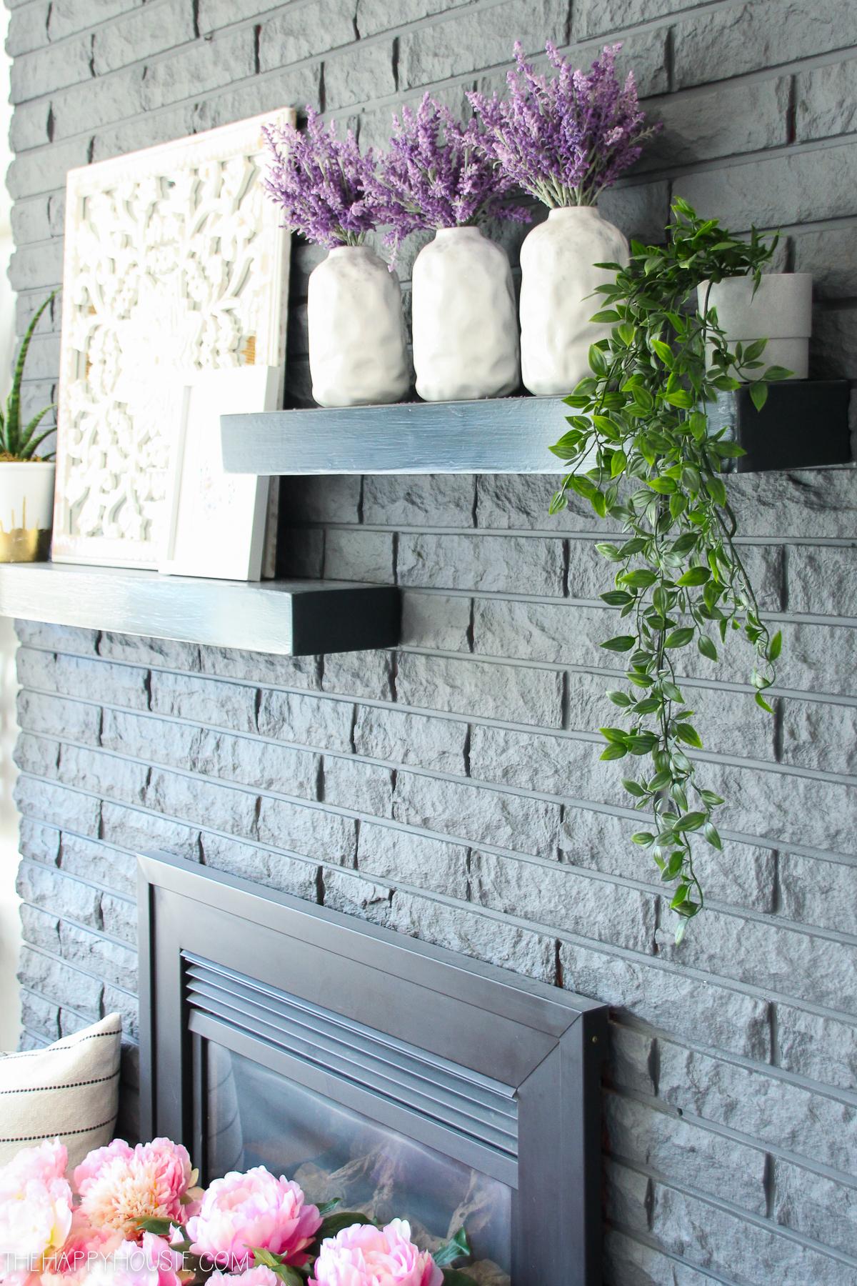 The grey brick fireplace mantel.