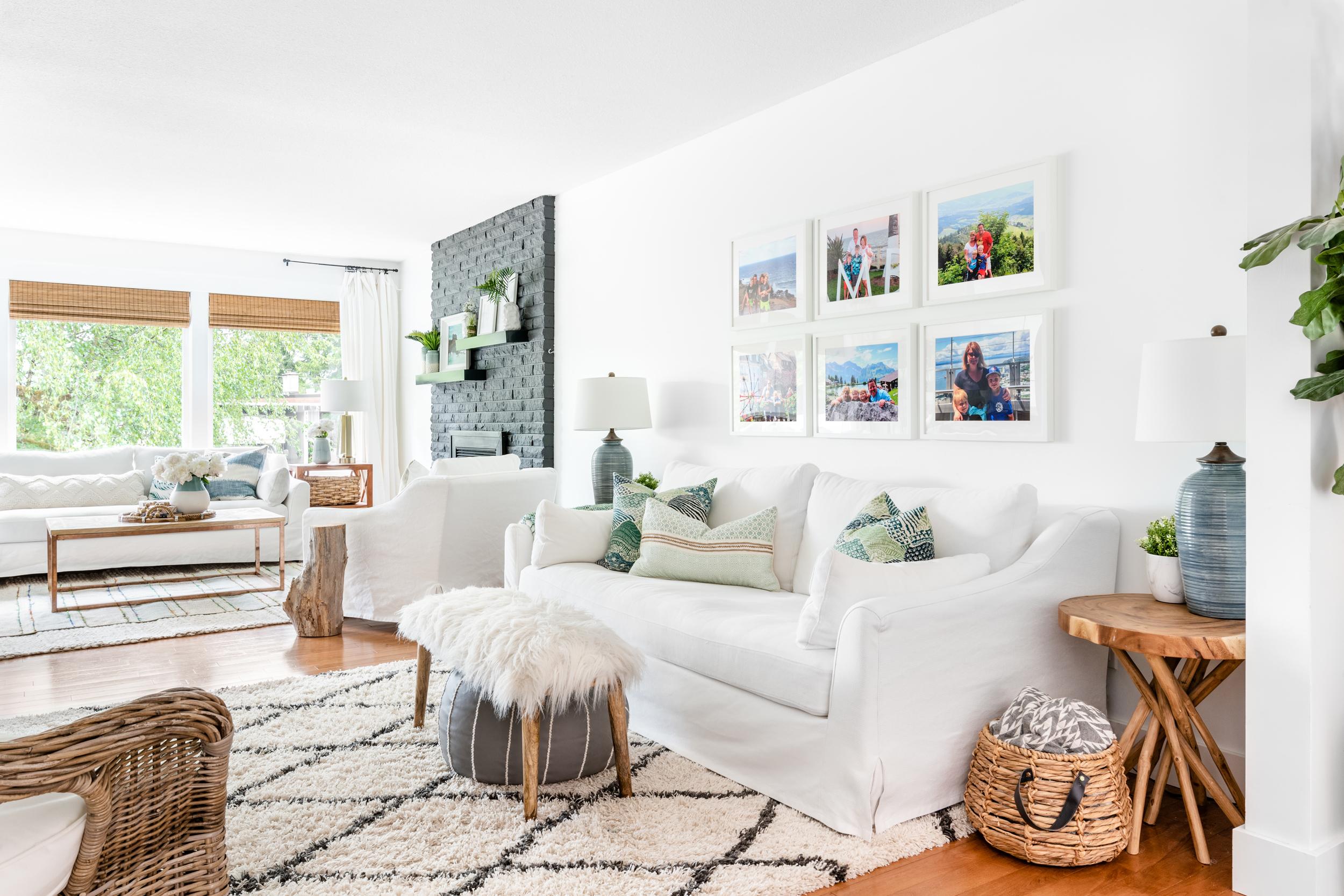 a living room area with a white Ikea Farlov slipcovered sofa and cozy plush area rug