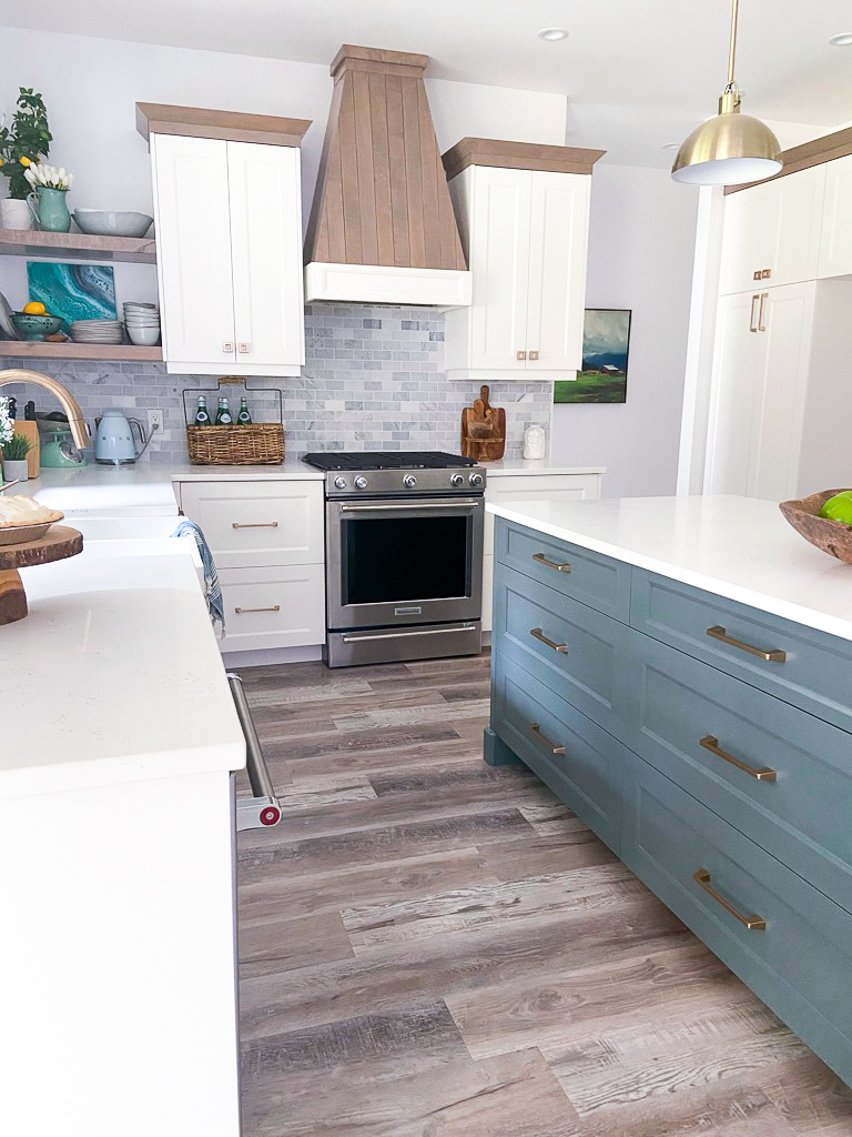 white kitchen with vinyl plank floors